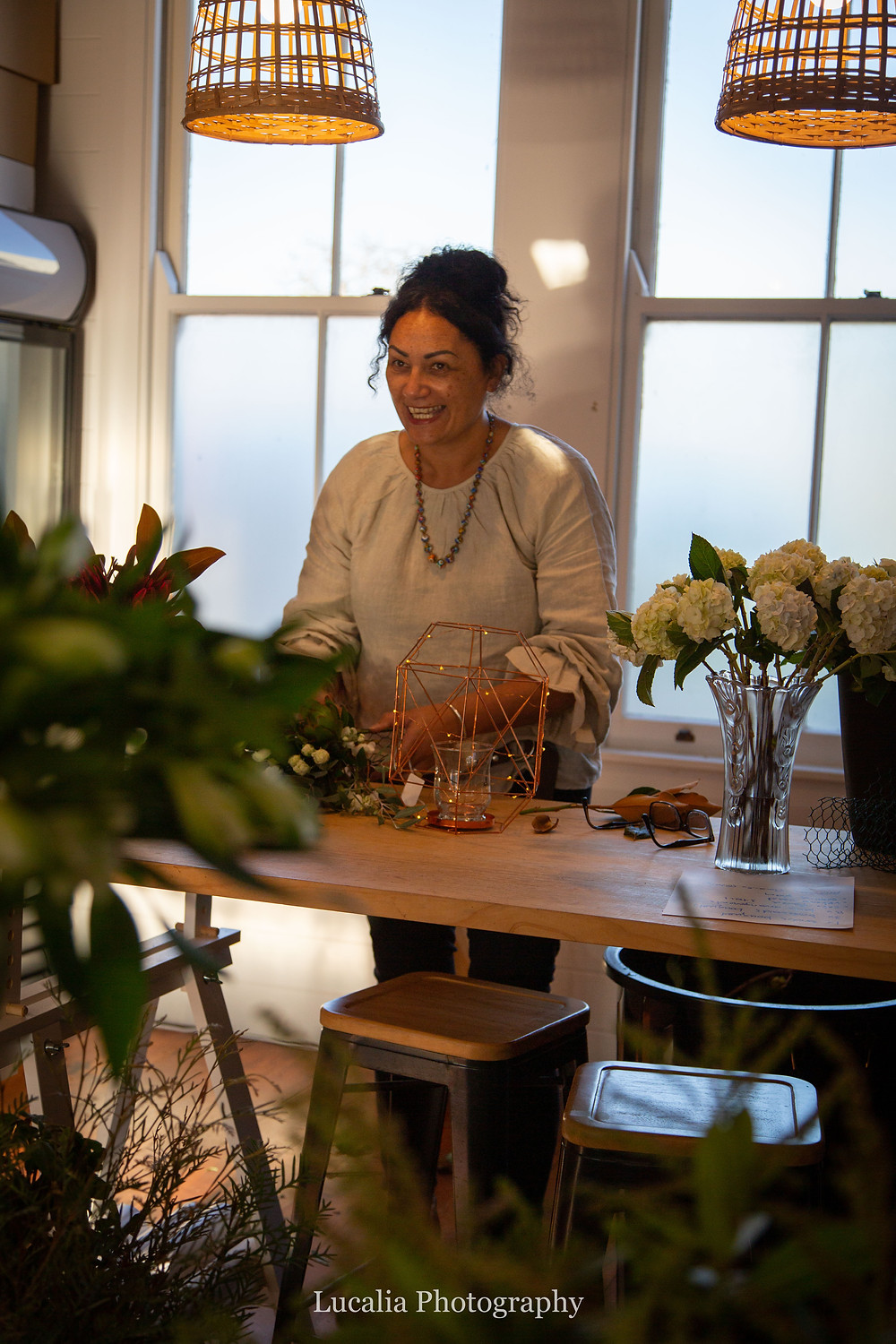 wedding florist laughing with flowers and copper vase, Wairarapa