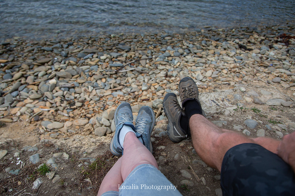 his and hers crossed legs on a rocky shore, Wairarapa photographer