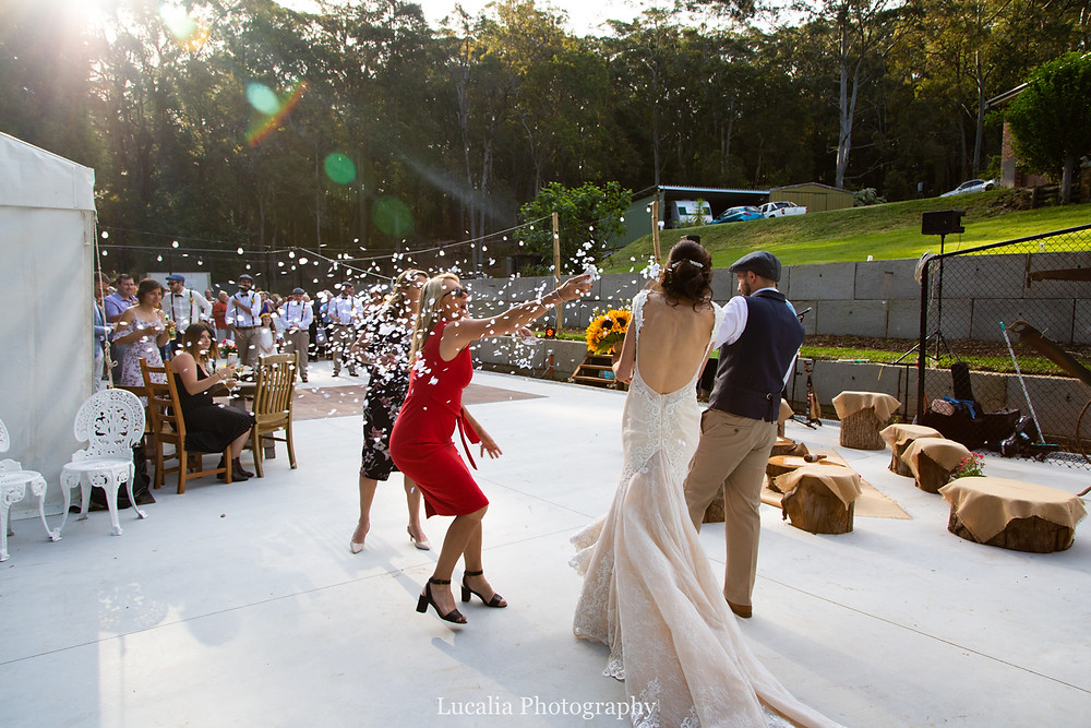 bride and groom entering their marquee outdoor wedding reception, Wairarapa wedding photographer