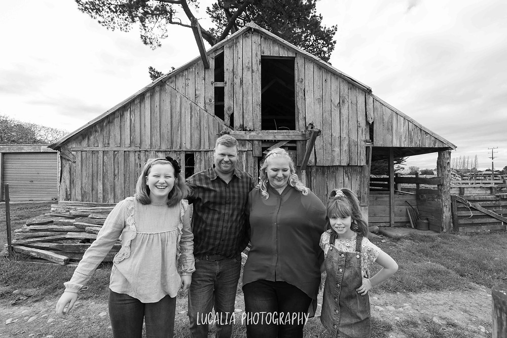 family laughing outside an old woolshed, Wairarapa wedding photographer