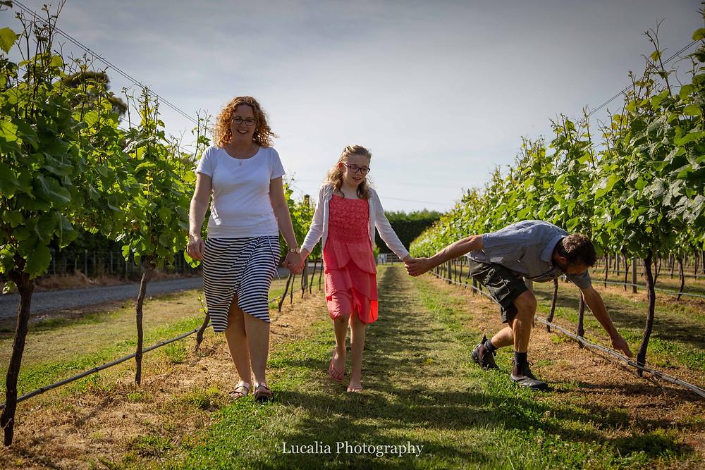 family walking amongst vines, Wairarapa family photographer