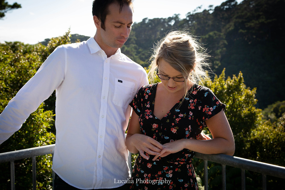 husband-to-be looking down at his fiancee's engagement ring, Zealandia, Wellington