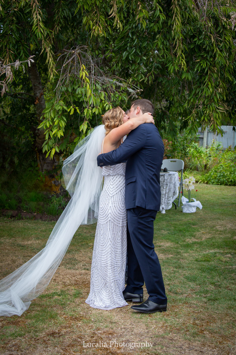 bride and groom kiss wedding ceremony, Wairarapa wedding photographers