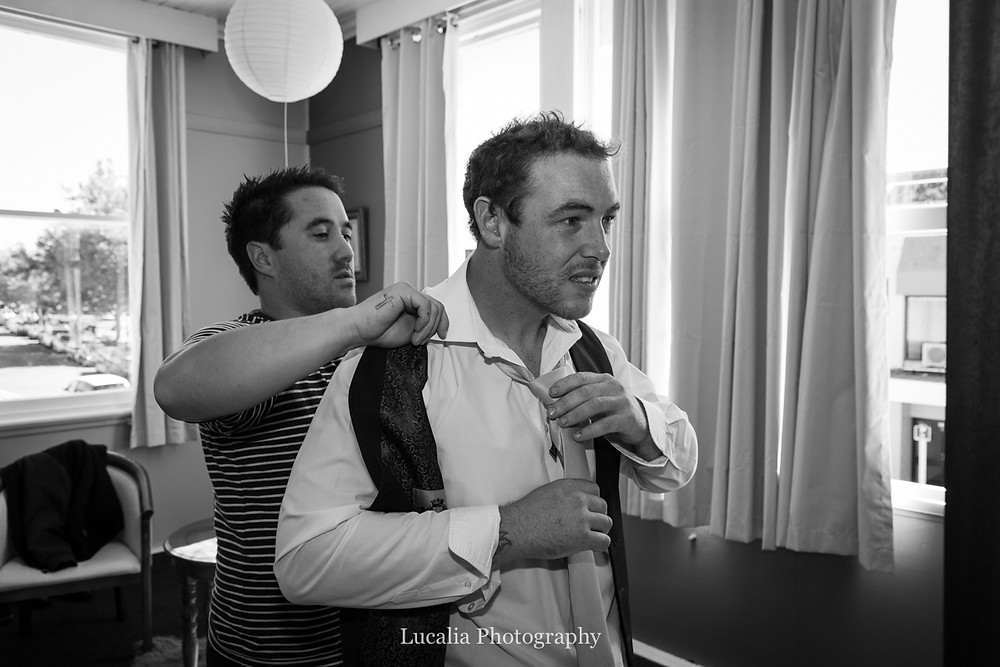 groom being helped get ready by best man, Wairarapa