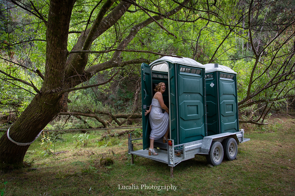 bride entering portaloo at forest wedding reception, Wairarapa wedding photographers