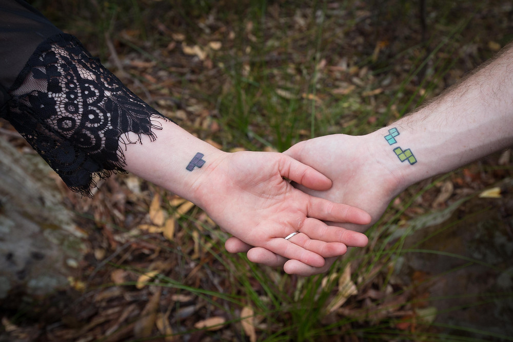 engaged couples hands tetris tattoos in the forest, Wairarapa