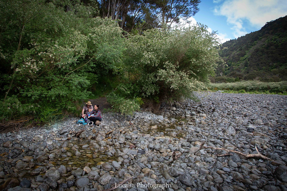 family eating lunch on the rocky banks of a river, Tararua Forest Park, Wairarapa family photographer