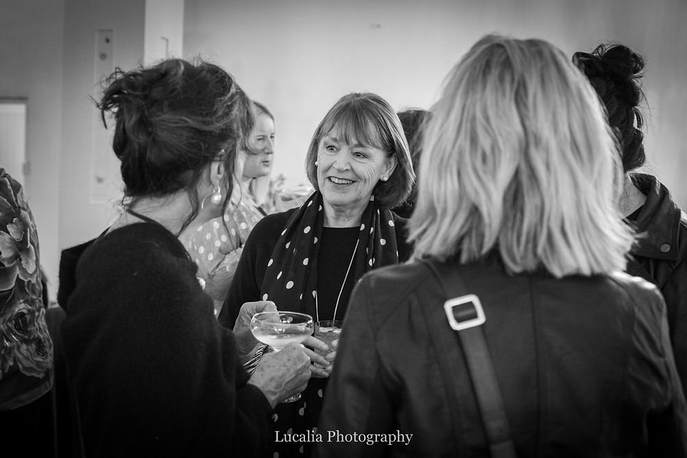 guests smiling and talking at Rose & Smith at Tauherenikau Wairarapa wedding venue