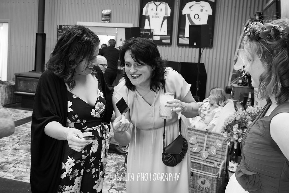 wedding guests with polaroid photos, Waimeha Bar and Grill, Ngawi Wairarapa wedding photographer