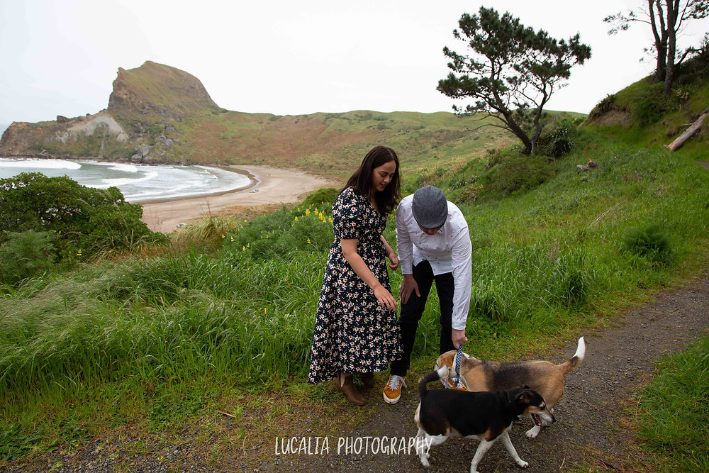 engaged couple at Castlepoint with their dogs, Lucalia Photography Wairarapa wedding photographer