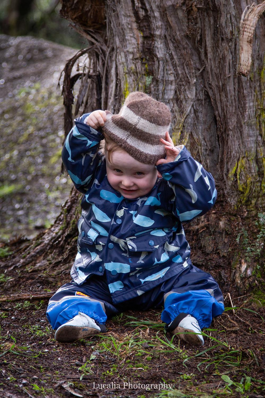 boy taking off his woolen beanie, Wairarapa family photographer