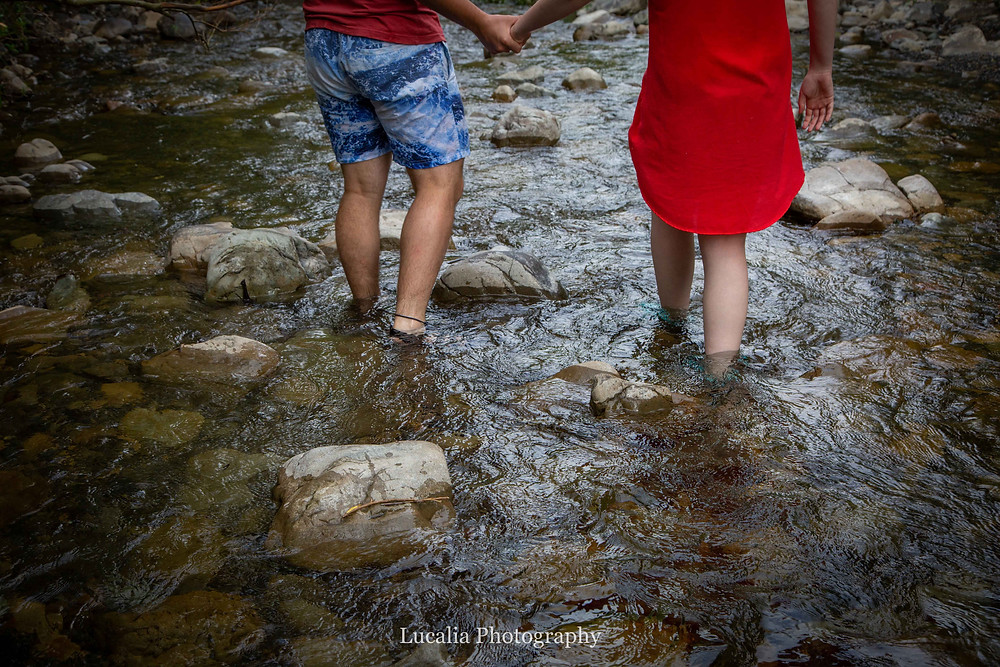 engaged couple walking in a river holding hands, Featherston Wairarapa