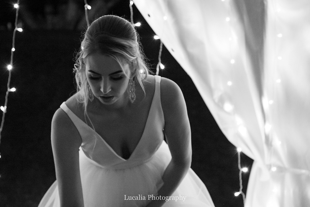 bride with fairy lights and marquee at her wedding, Wairarapa
