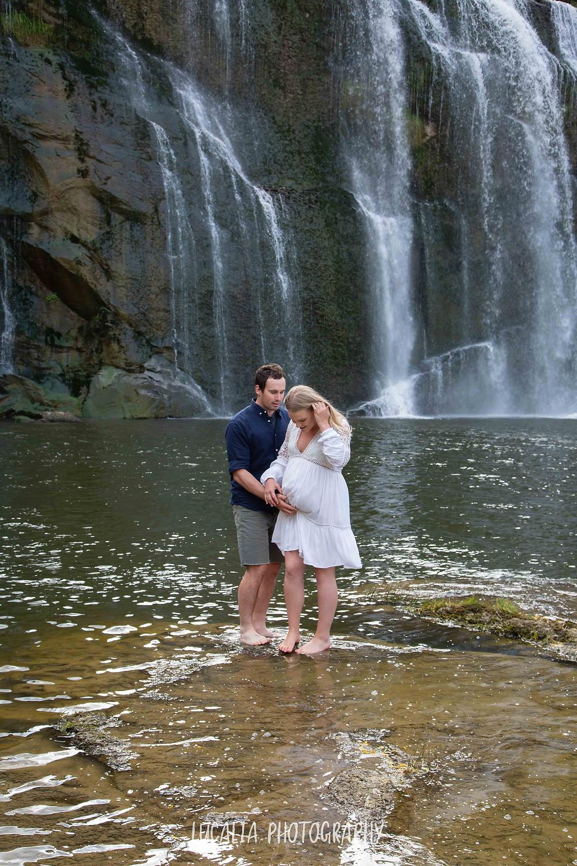 couple paddling in waterfall maternity portrait, Wahi Falls, Tararua, Lucalia Photography
