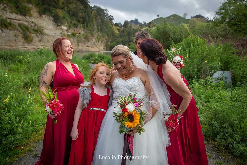 bride and bridesmaids laughing, Wairarapa wedding photographer