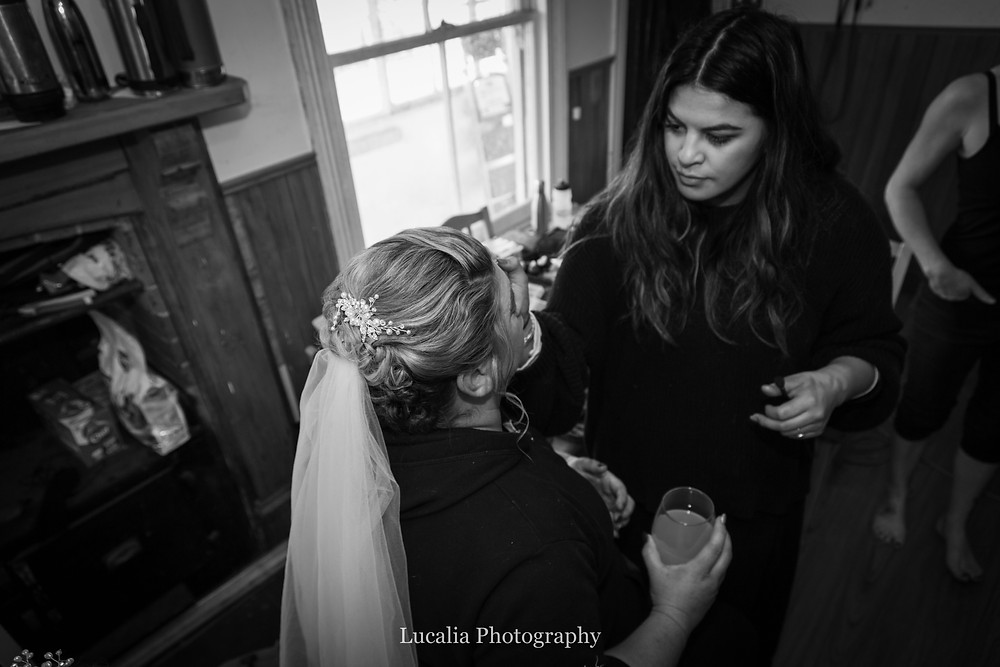 bride having her madeup touched up, Wairarapa wedding photographer