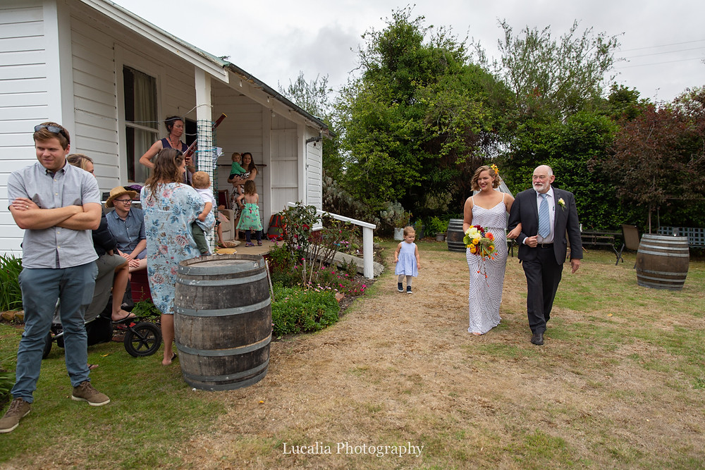 bride and her dad walking down the aisle, Wairarapa wedding photographers