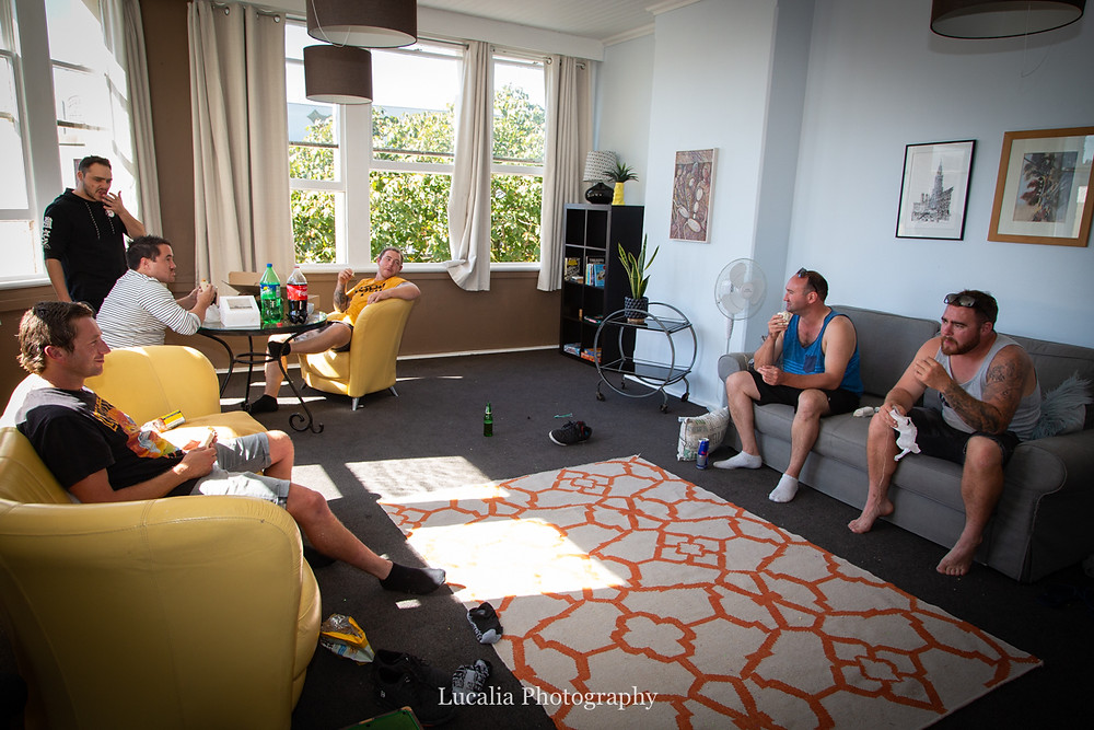 groom and groomsmen relaxing in airy apartment, Wairarapa
