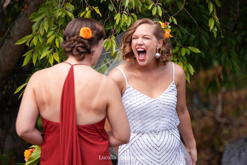 happy bride with bridesmaid, Wairarapa wedding photographer