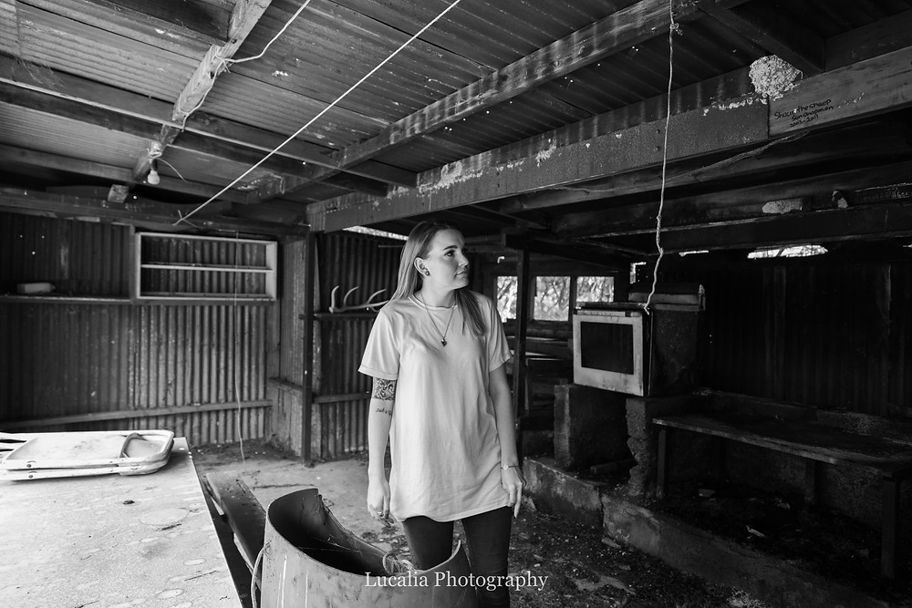 bride-to-be standing inside old shed, Wairarapa wedding photographer