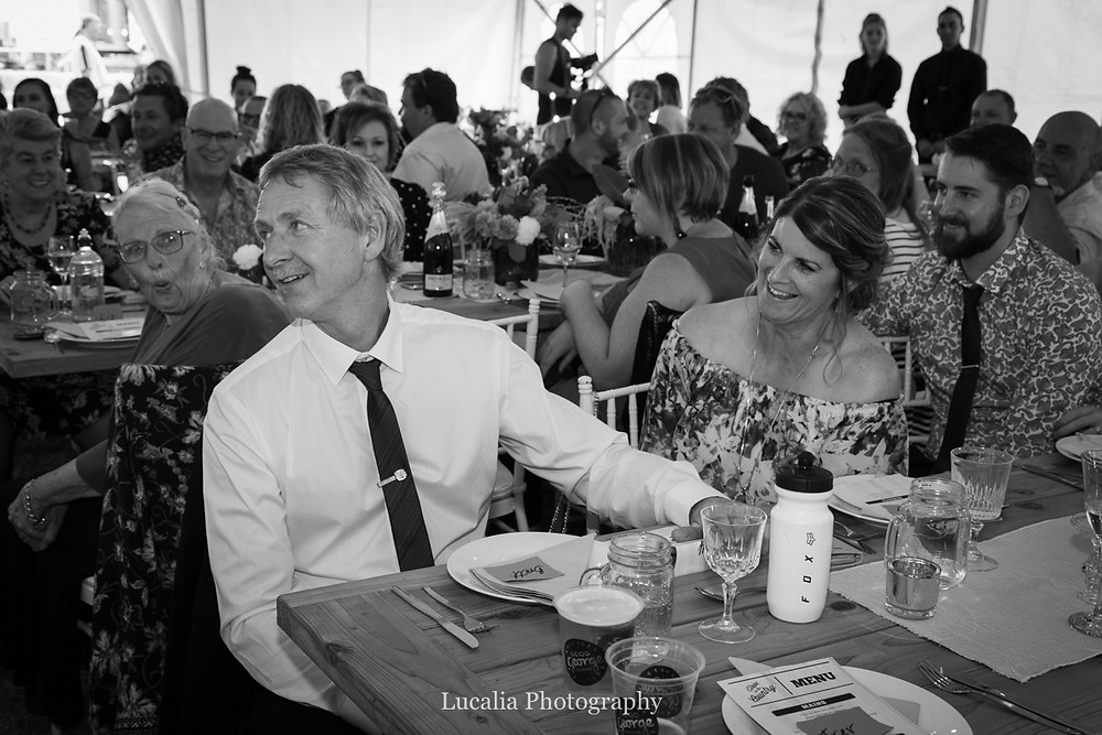 father of the bride laughs during wedding reception, Wairarapa