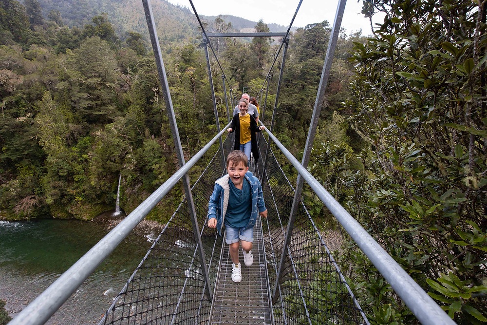 family crossing suspention bridge Waiohine Gorge, Wairarapa family photographer