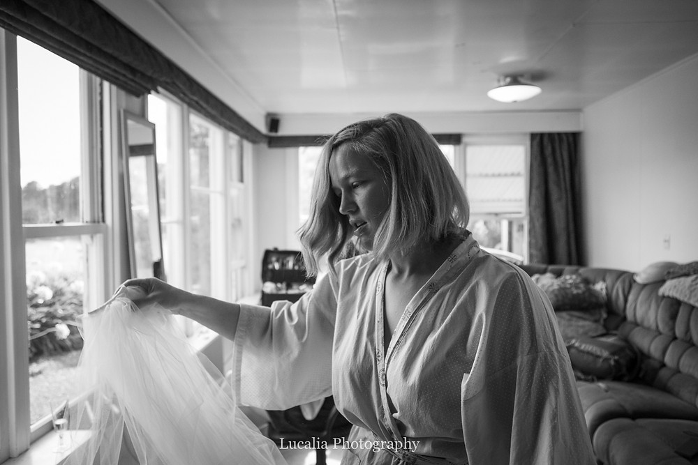 bride admiring her wedding veil, Wairarapa wedding photographers