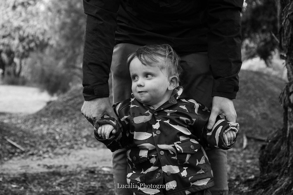 father holding his son's arms in a forest, Wairarapa family photographer
