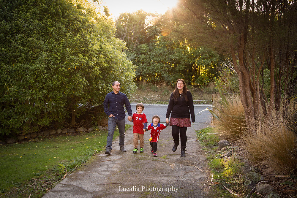family walking down path with trees, Wairarapa family photographer