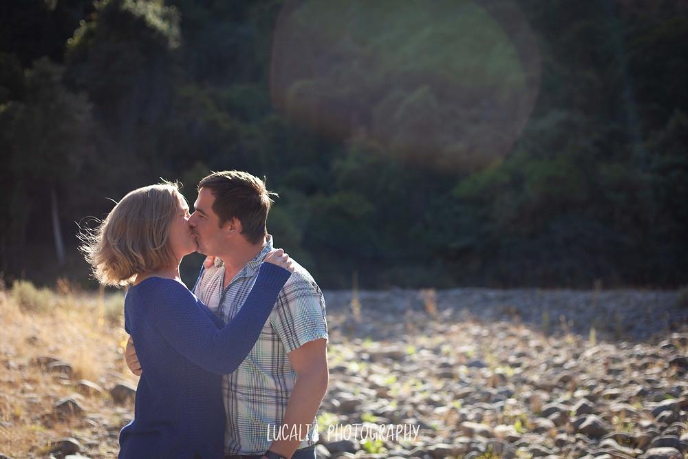wedding couple to be kissing in afternoon light, Martinborough Wairarapa wedding photographer
