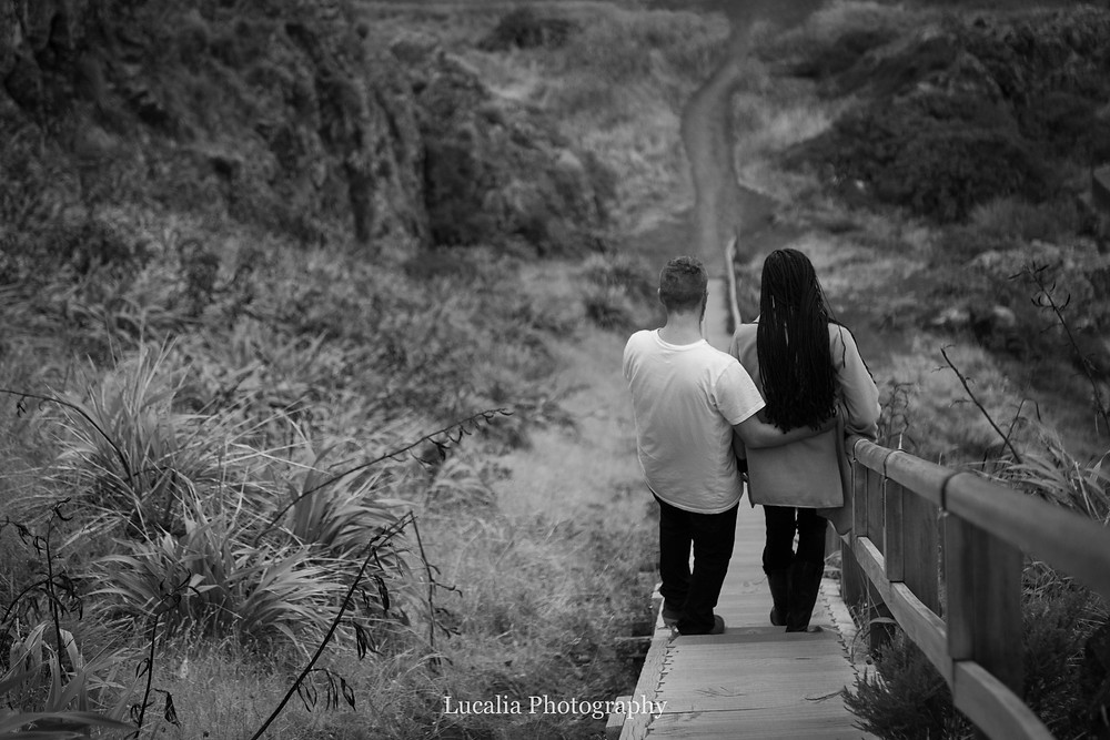 engaged couple walking down the stairs at Cape Palliser lighthouse, Wairarapa