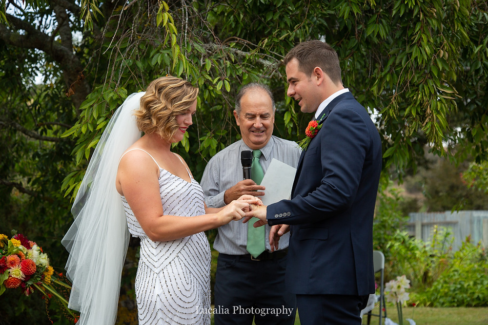 bride putting on groom's ring, Wairarapa wedding photographers