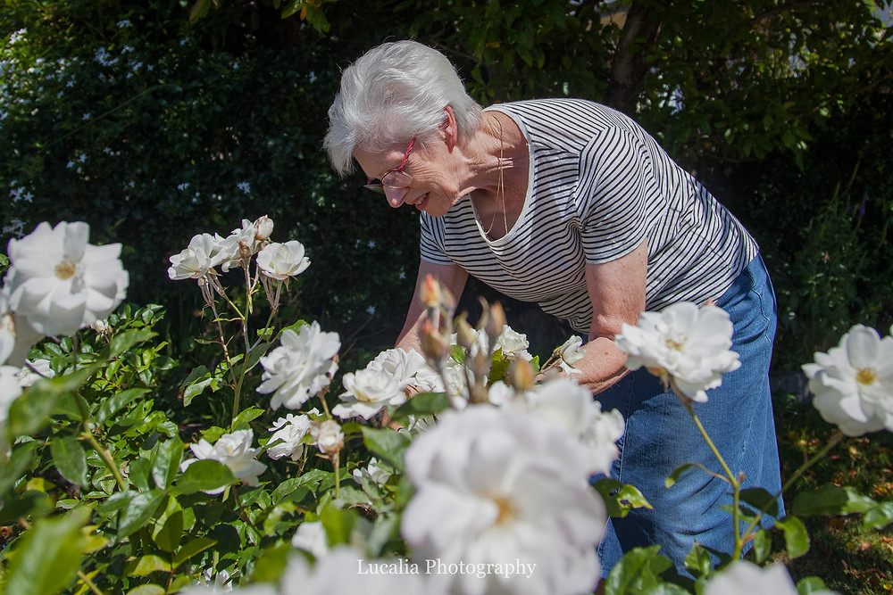mother of the bride picking roses on her daughter's wedding day, Wairarapa wedding photographer