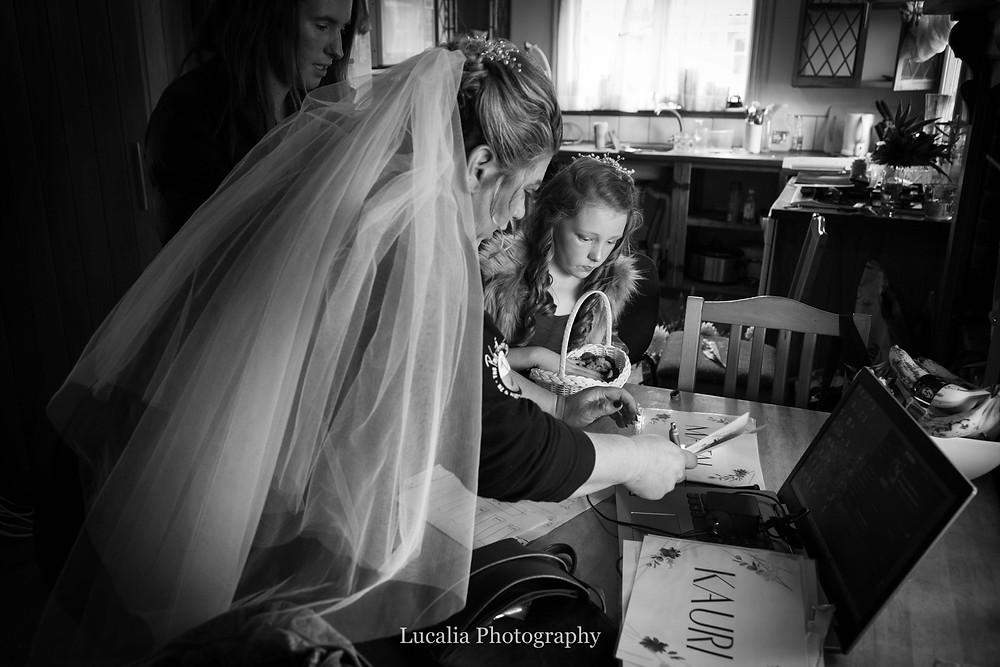 bride and flower girl illuminated by window light, Wairarapa wedding photographer