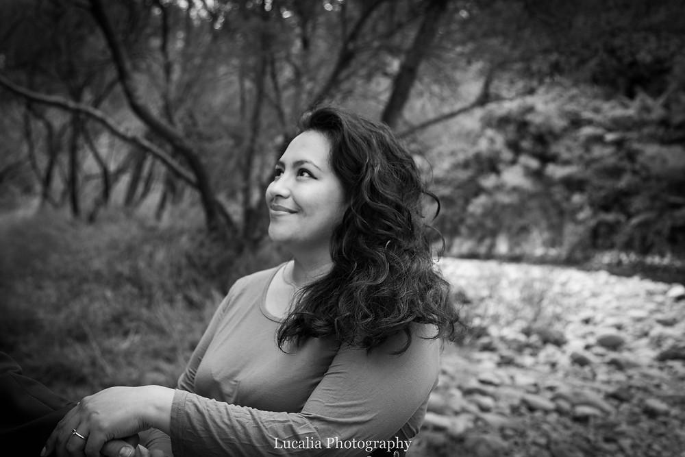 Fiancee smiling next to a river, Wairarapa