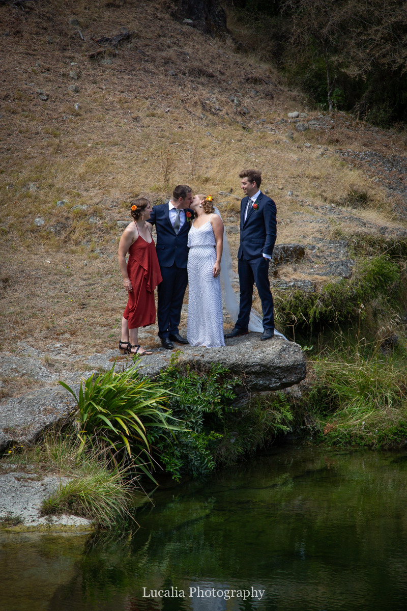 wedding party portrait on rock near river, Wairarapa wedding photographers