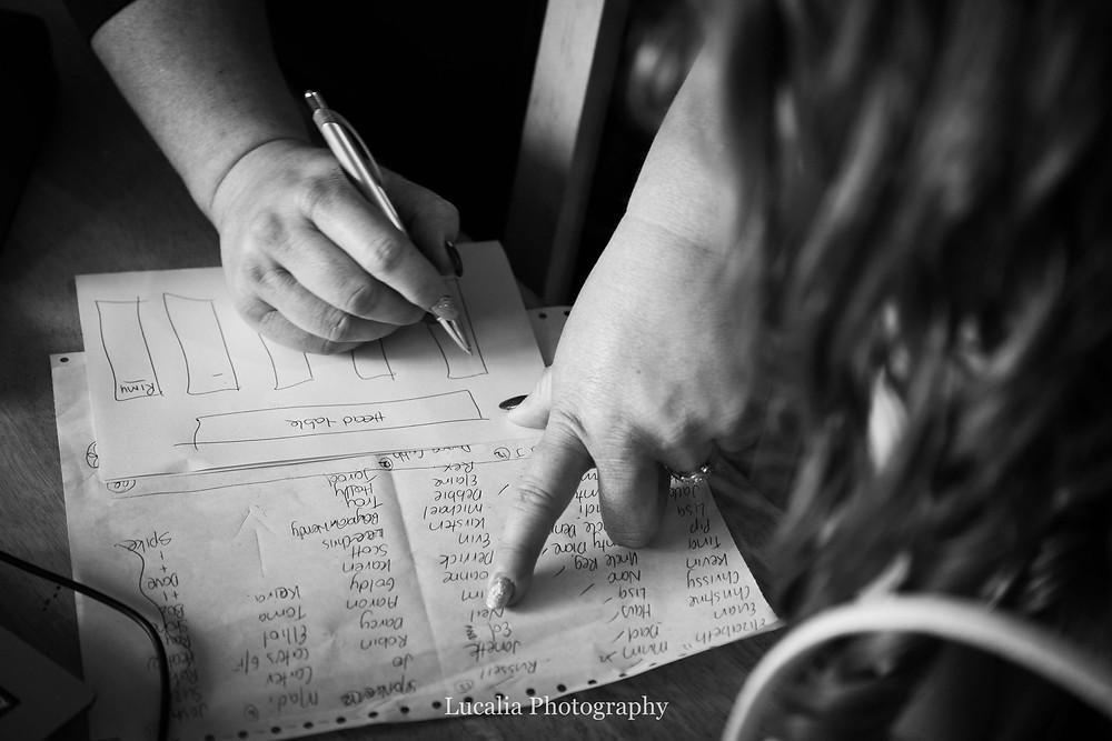 bride writing seating plan, Wairarapa wedding photographer