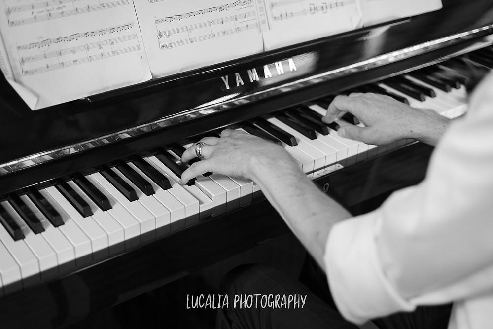 groom playing the piano, Castlepoint Wairarapa wedding, Lucalia Photography