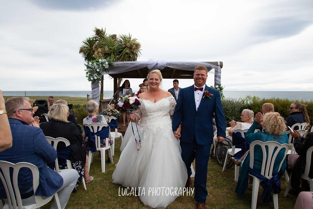 happy couple walking back down the aisle during their wedding ceremony, Ngawi Wairarapa wedding photographer