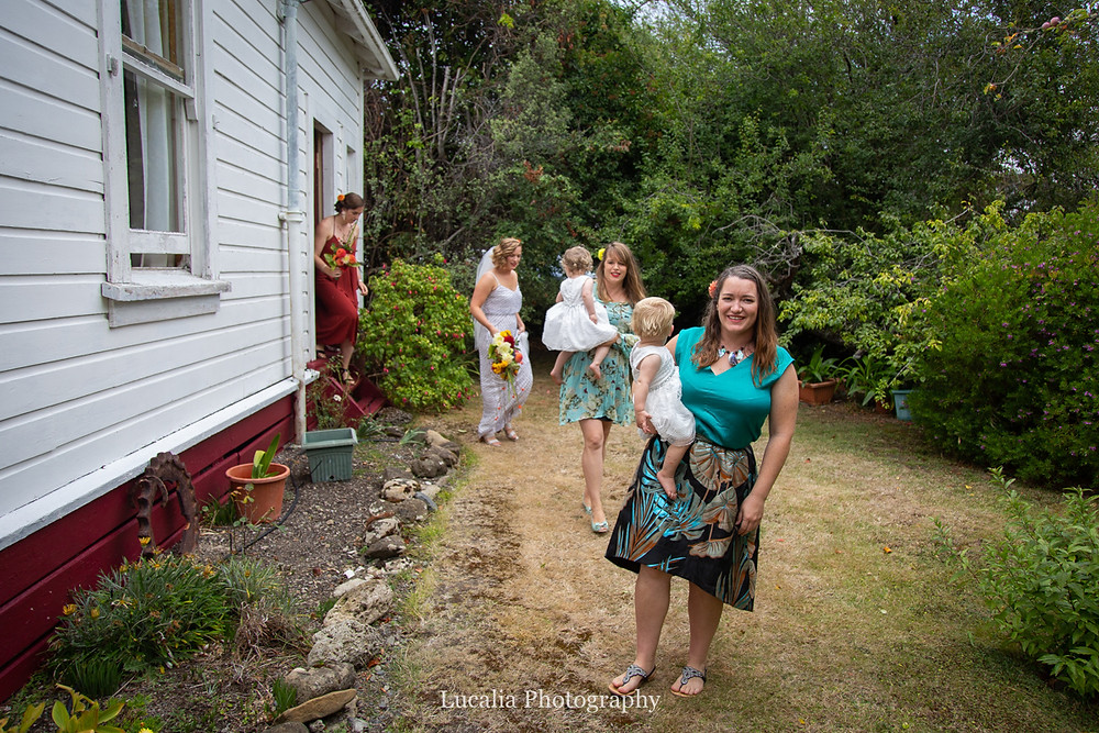 Bride and wedding party walking out of the house towards the garden ceremony, Wairarapa wedding photographers
