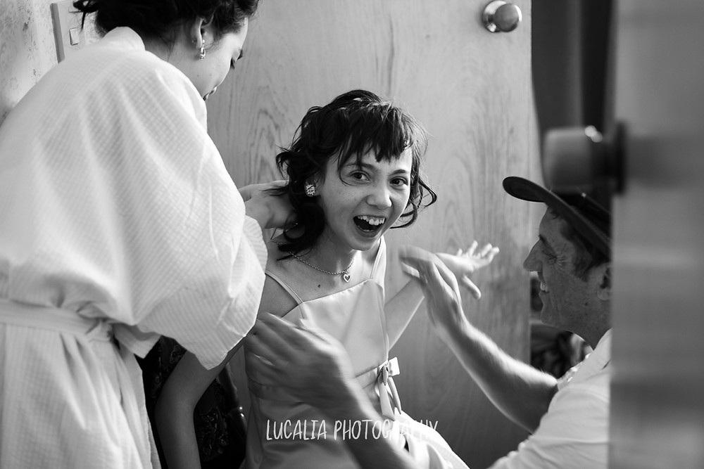 bridesmaid getting ready, accessible wedding, Castlepoint Wairarapa wedding, Lucalia Photography