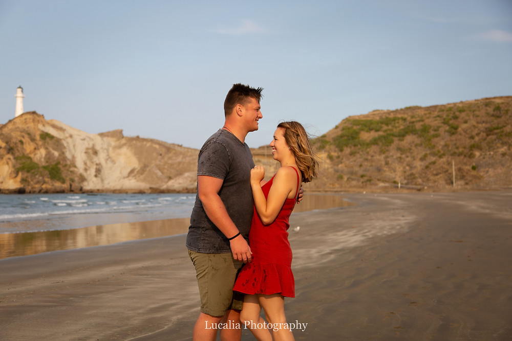 engaged couple on the beach at Castlepoint, Wairarapa