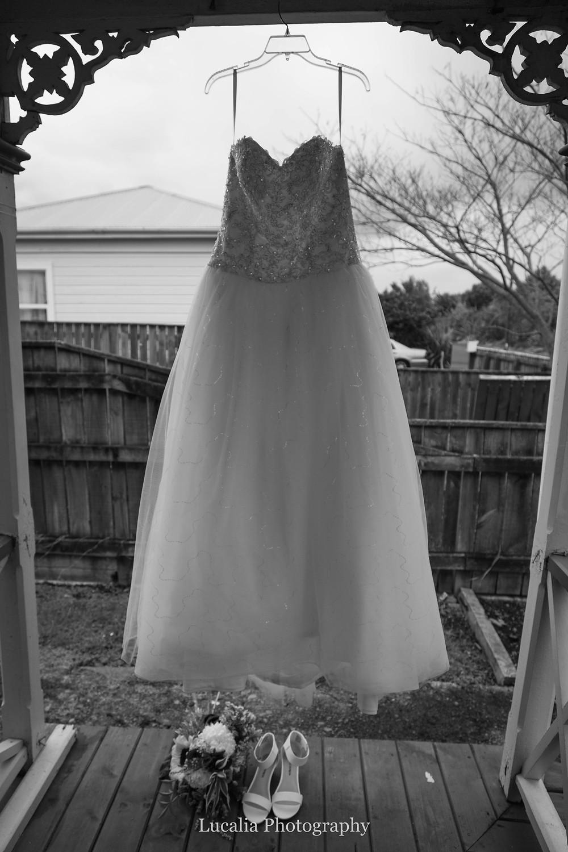 wedding dress hanging up outside with ironwork detail, Wairarapa wedding photographer