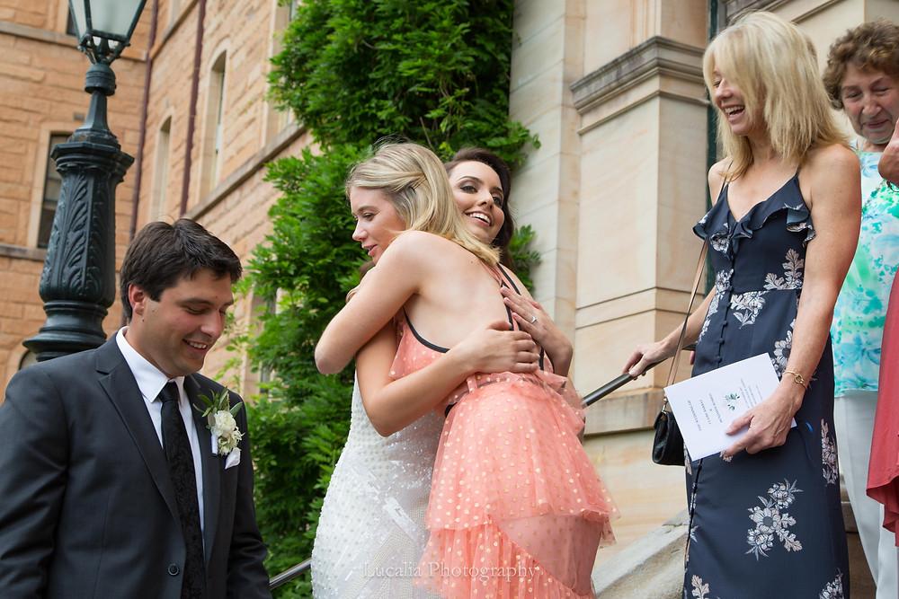 bride hugging guests with groom, Wairarapa wedding photographer