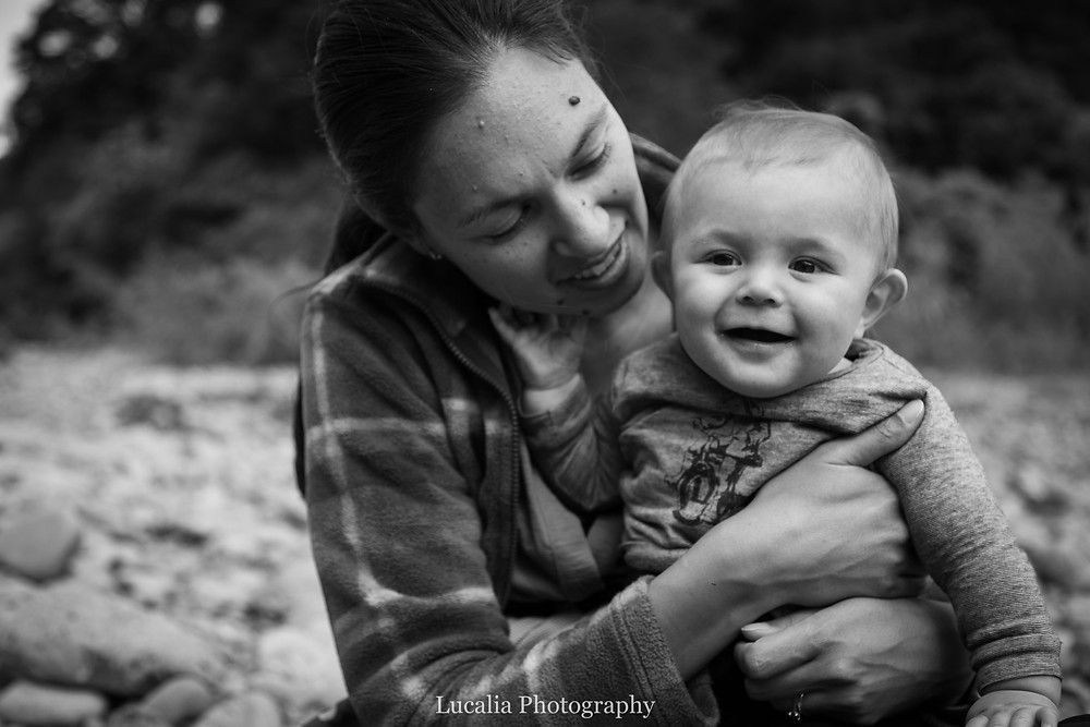 mum holding laughing 6 month old baby, Tararua Forest Park, Wairarapa family photographer