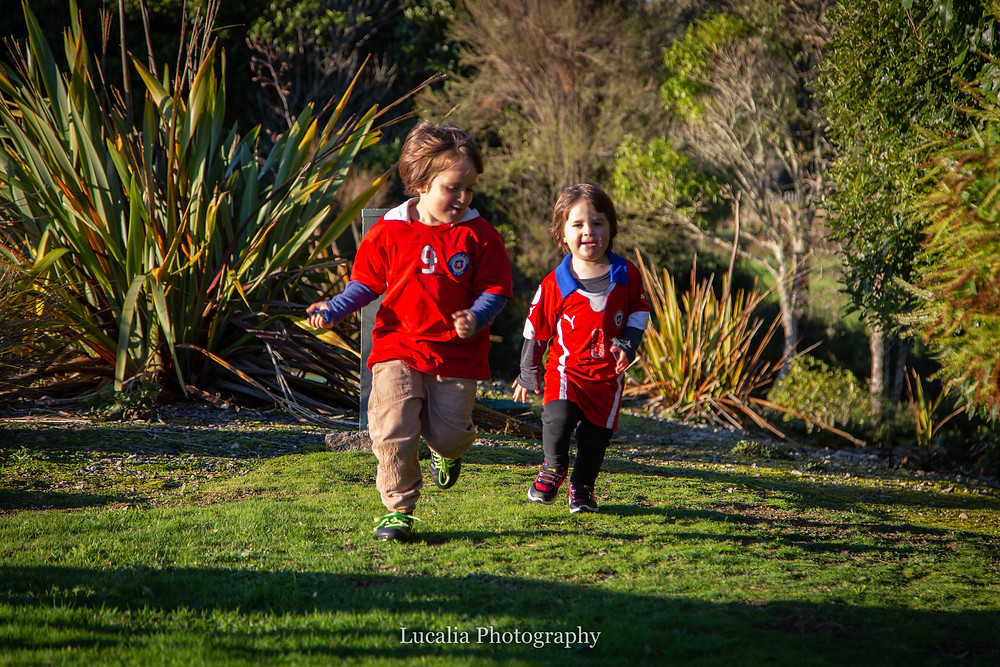 two boys running wearing soccer shirts, Wairarapa family photographer