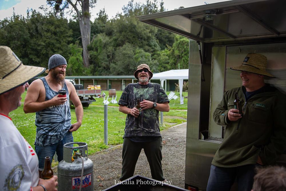 groom and groomsmen laughing, Wairarapa wedding photographer
