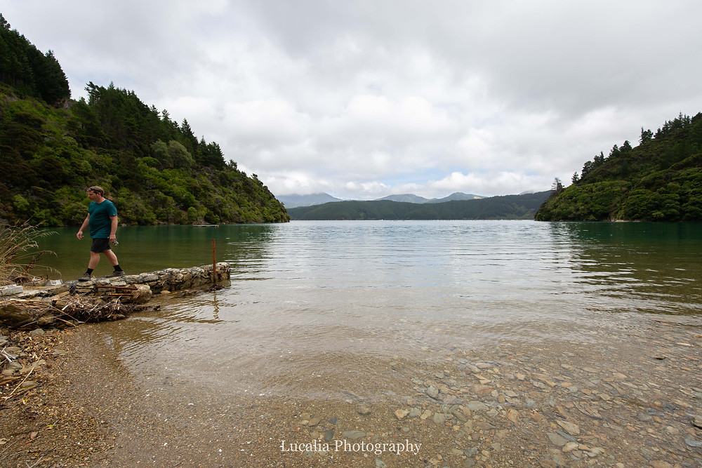 walking along a stone wall in the bay, Wairarapa photographer