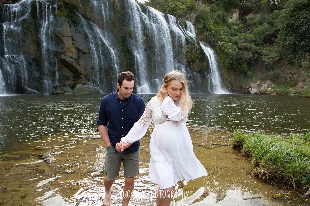 pregnant lady leading partner away from waterfall, Wahi Falls, Tararua, Lucalia Photography