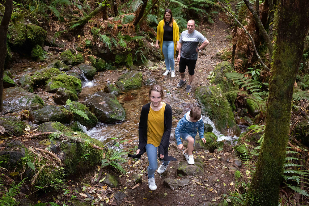 family walking across a stream, Waiohine Gorge, Wairarapa family photographer